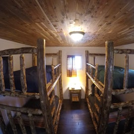 Dry PINE cabin 17 has 2 bunk beds and cabin 16 and one bunk bed and a couch. No bath or water but under $100. Other cabins with baths and homes from $125 to $350.