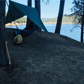 This is a camp ground (with a fire ring and vault-like toilet)