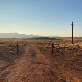 Gate from outside, facing down the road to the canyon edge