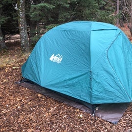 A very generous mulch tent pad. I used the REI Half Dome 3 Plus and had more than enough space.