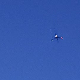 Plane overhead, campsite is on a direct flight path