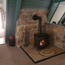 Gas fireplace in entry room