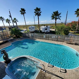 Pool and hot tub behind the main clubhouse