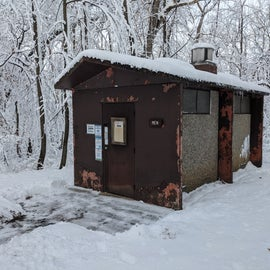This is the decrepit pit toilet serving the walk in sites. When looking at a map, choose sites on this side of the path, they are further from the road and have an extensive woods behind them.