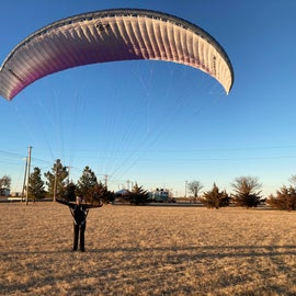 My wife getting some practice kiting her paramotor wing