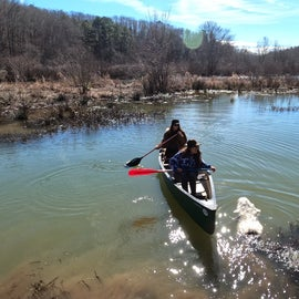 The lake is great for canoeing. Make sure to paddle upstream going towards the bridge to check out the creek.