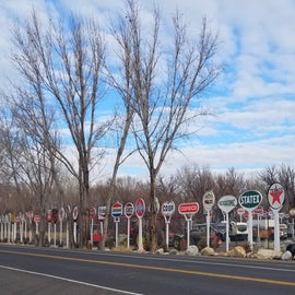 A big oil company sign collection decorates area businesses by the RV park.