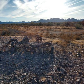 Rock art with mountains in the background.