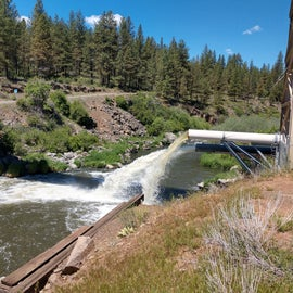This is the run off from the dam. There's a pipe that takes water, maybe for irrigation, alongside the river beyond the dam.