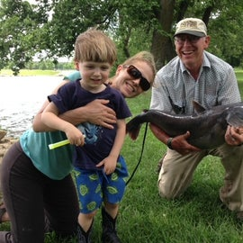Photo bombed by our daughter and grandson.  Fred the Fisherman and his 20 lb Channel Catfish.
