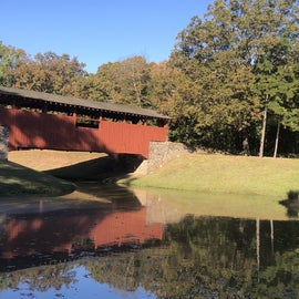 A beautiful covered bridge is within walking or running distance