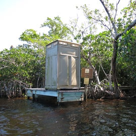 Dock with porta-potty at lard can. Canoe grounding is in the mangroves to the right of the dock.