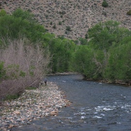 walking down the rocky shore of the Encampment River Campground. View from the bridge that overlooks the river.
