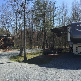 Site 93 with patio, rot iron table and chairs, fire pit, and stand up bbq.