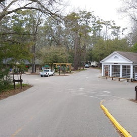 Entrance to campsites. Store and bathrooms/showers on left, and one of the cabins to the right.
