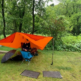 A rainy weekend. We had three hammocks and a tarp on this site.