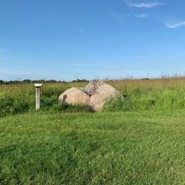 Glacial boulder on prairie interpretive trail
