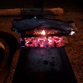 Cooking dinner over the firepit.