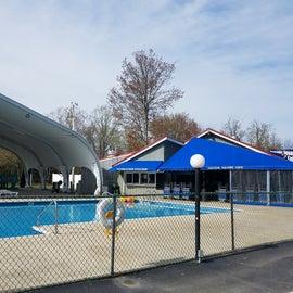 Large pool next to amphitheater venue and café.