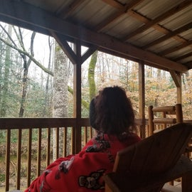 relaxed on cabin porch