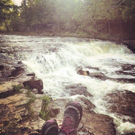 Relaxing at the falls before hiking the trail