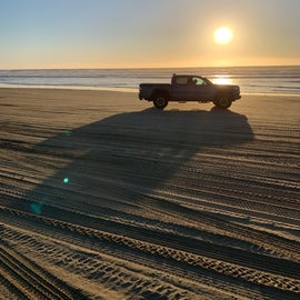Driving on the beach at sunset, lowtide