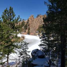 Crow Creek trail to Hidden Falls.  Frozen lake with snow.  Majestic pink granite walls