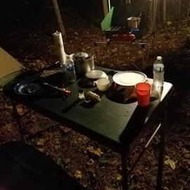 Preparing dinner at the campsite.
