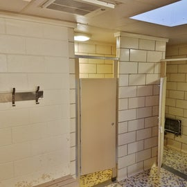 The showers have a large waiting area.