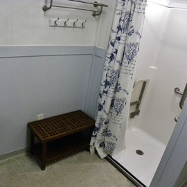 Bath House had Individual shower/toilet combos.