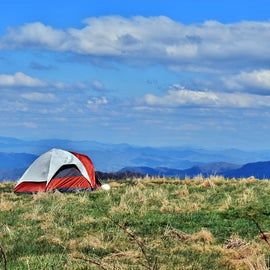You can set up your tent on the summit, but you have to be 200 feet away from the AT.