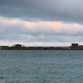 Concrete ships form barrier.