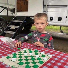 learning how to hustle his dad in checkers