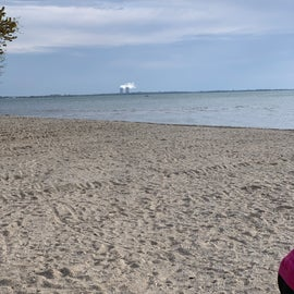 Small beach on Lake Erie with a view of Fermi 2