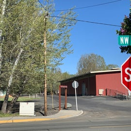 look for red barn at this intersection and drive on the north side