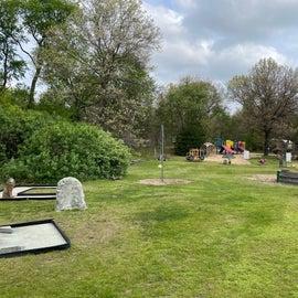 playground with Gaga pit , slides, mini golf, sandbox with diggers