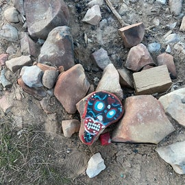 This was the rock that was there when we first arrived my daughter came up with the idea of adding to the collection her her and her friend started painting rocks the whole weekend.