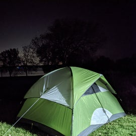 Our campsite at night ( vehicle headlights).