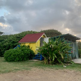 The yellow house is 2 bathrooms, the outdoor beach showers and sink in green on the right.