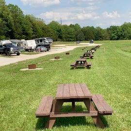 Picnic Tables and Fire Pits Across from Sites