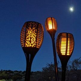 We love our solar tiki lights