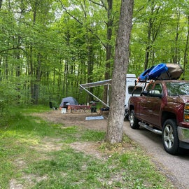 Site 85 with camper and tent.  2 vehicles