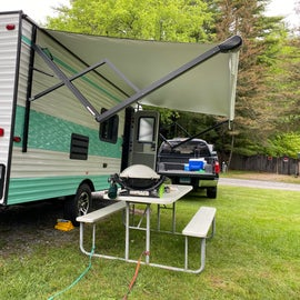 our new camper (  picknic tables provided by the campground )
