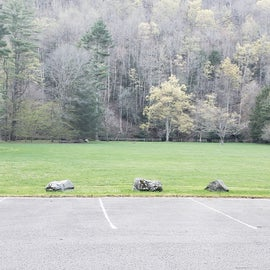 Parking near the central field. river access is on far side of this field or from individual campsites