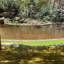 stone pool by a stream