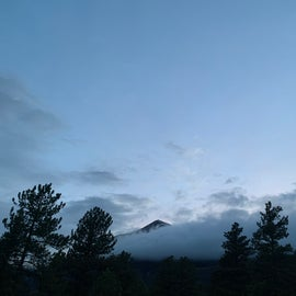 mountiains peeking from the clouds