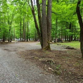 the road that cuts through the middle of the campground is on the right