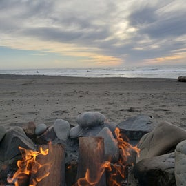 Fire on the beach with wine. It doesn't get much better.