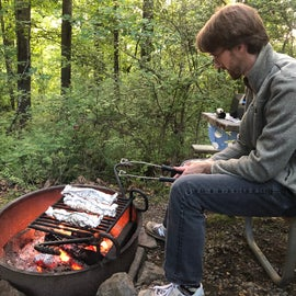 Sitting on the picnic table & cooking dinner at the fire ring