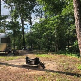 Site 55 camp fire ring opposite side of camper door